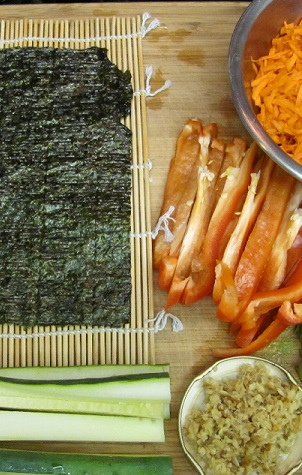 raw vegan nori roll ingredients laid out and ready to go
