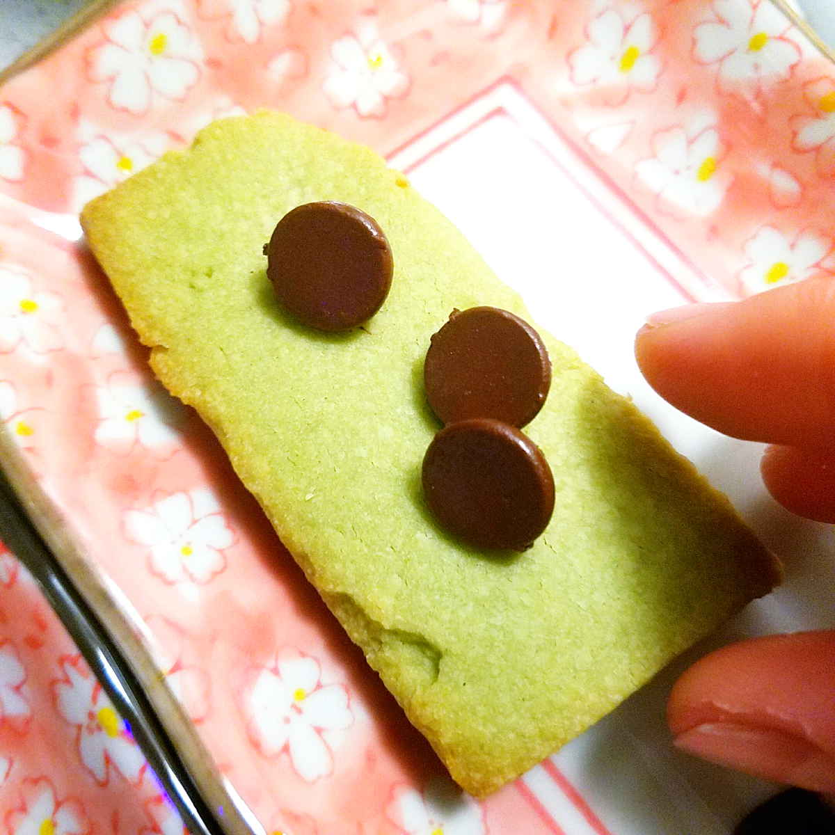 close up of a matcha shortbread cookie