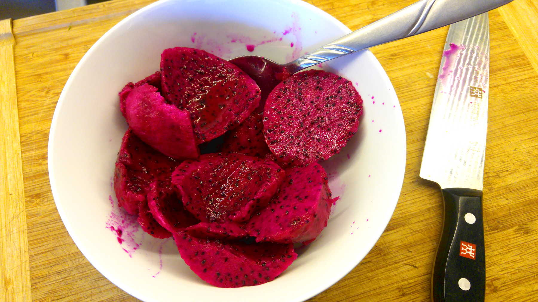 dragon fruit chunks cut up in a bowl