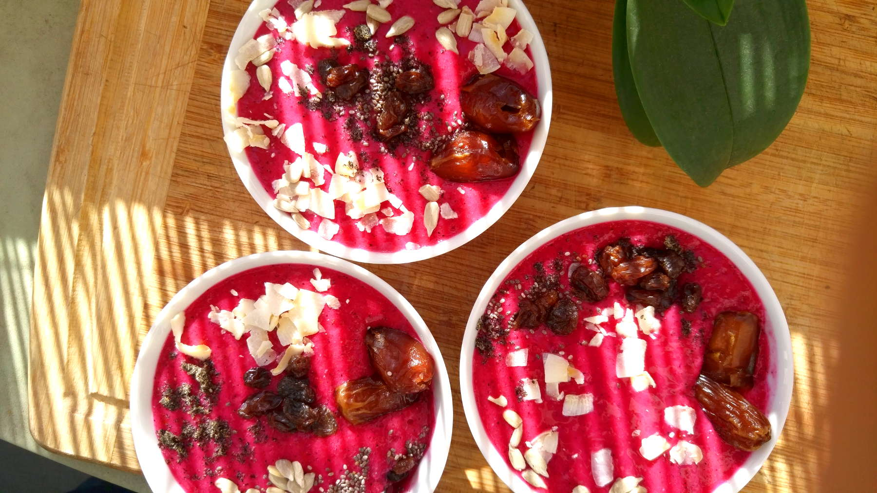 3 dragon fruit smoothie bowls with toppings
